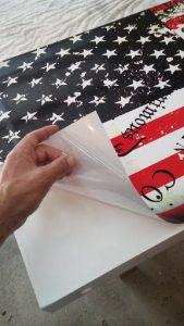 Remove cornhole wrap backing starting at the corner